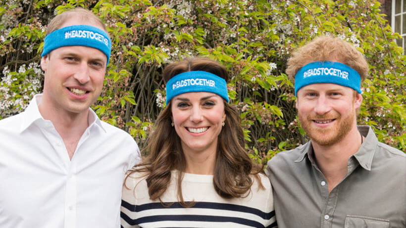 Duke of Cambridge, Duchess of Cambridge and Prince Henry of Wales standing together