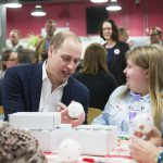 The Duke of Cambridge gets involved with bauble decorating.